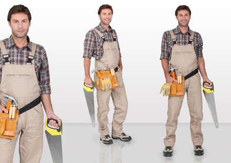 handsaw: Carpenter holding hand-saw