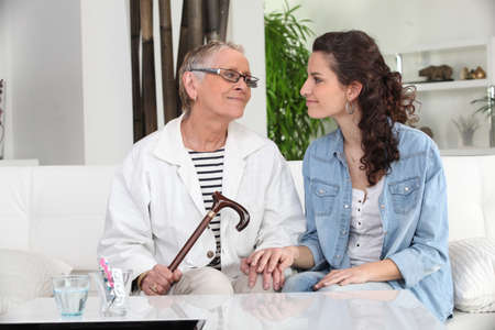 ailing: Young woman spending time with her grandmother Stock Photo