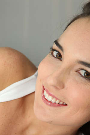 Closeup of a young woman smiling Stock Photo - 11775360