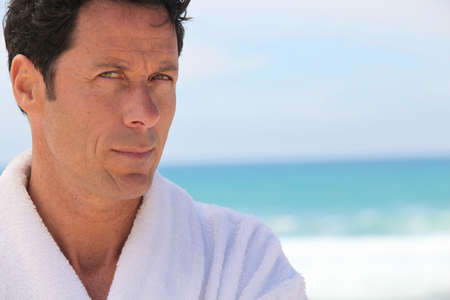 45 50 years: Man on the beach in bath robes Stock Photo