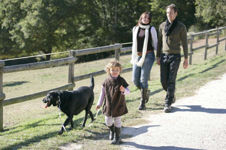 Family with dog in the countryside photo