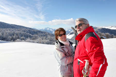 senior people in the snowy country photo