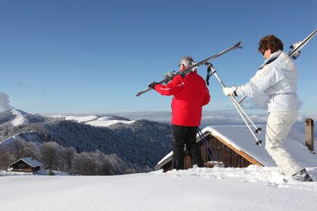 senior couple on a ski vacation photo