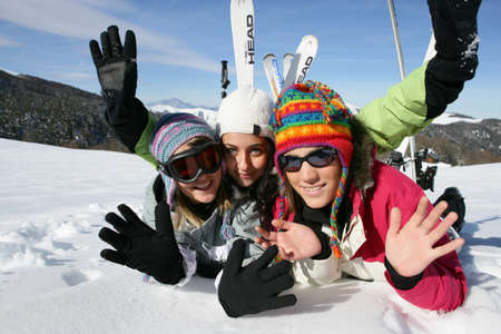 Teenagers on the ski slopes photo