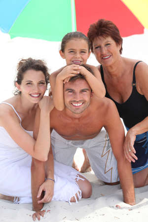 Family at the beach together photo