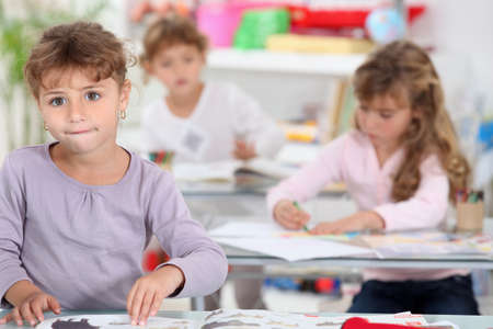 Three little girls in class Stock Photo - 11775428