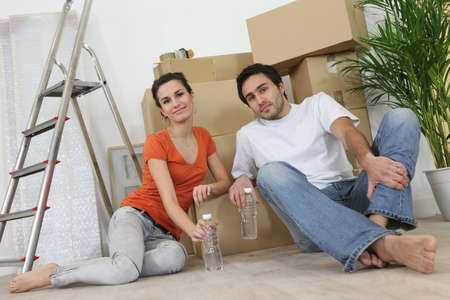 property ladder: Couple sitting inside an apartment