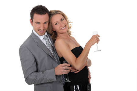 Couple with a glass of champagne Stock Photo - 11774536