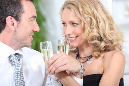 Closeup of couple drinking champagne photo