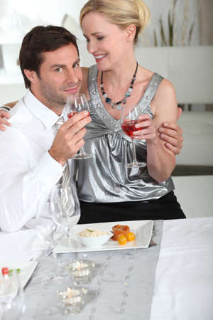 Couple having meal at home Stock Photo - 11776077