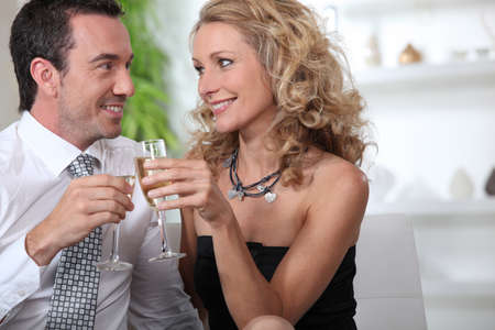 Couple celebrating with a glass of champagne Stock Photo - 11776611