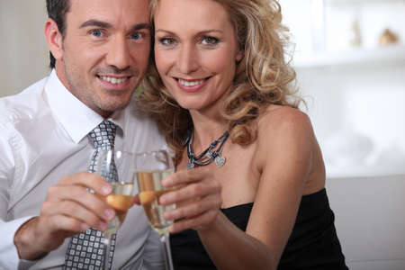 Couple celebrating at home with champagne Stock Photo - 11775801