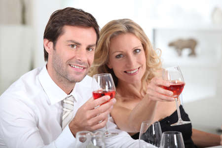 Couple holding wine glasses Stock Photo - 11775232
