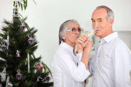 christmas eve: Senior man and woman celebrating New Year