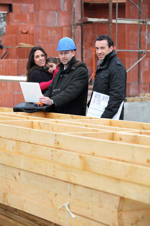 Architect with young family at construction site photo