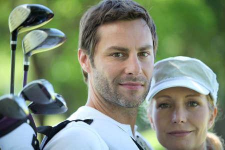 golfing: Golfing couple Stock Photo
