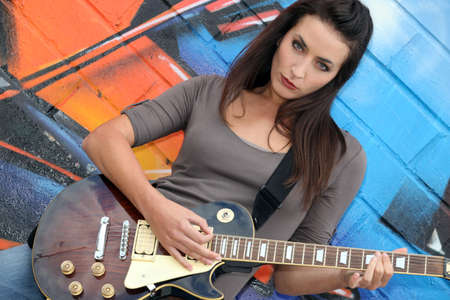 Musician with her guitar Stock Photo - 11777018