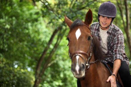 horseback: Young man riding horse