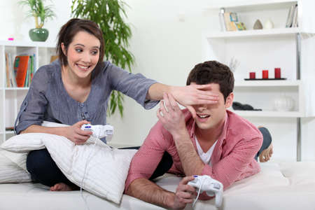 Teenagers playing video game. photo