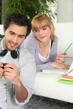 2 persons only: Young couple studying at home Stock Photo