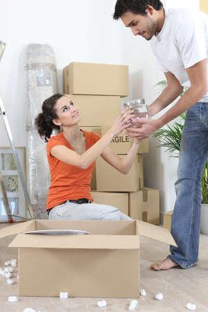 Couple unpacking belongings photo