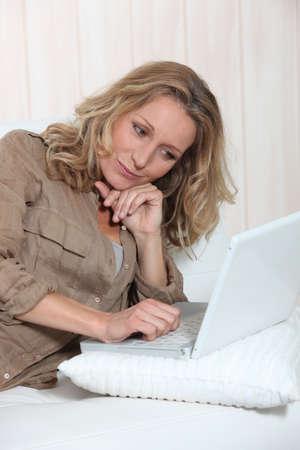 Woman on laptop photo