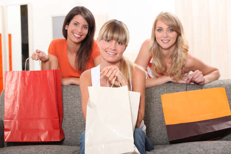 Friends with shopping bags photo
