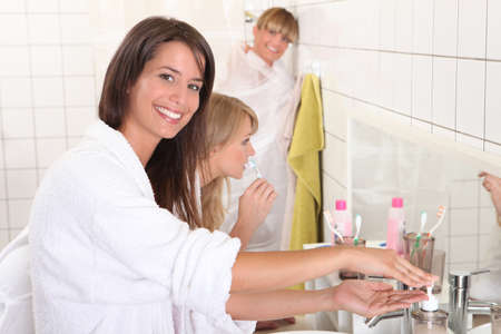 roommates: Young women getting ready for their day Stock Photo
