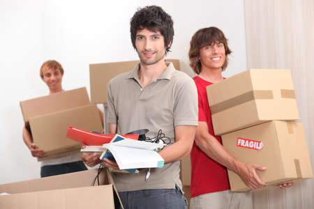 House mates carrying boxes Stock Photo - 11775183