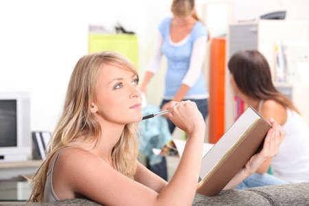 revising: Teenage girl revising at home Stock Photo