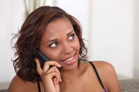 landline phone: Young woman talking on the telephone