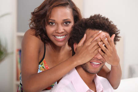 Playful couple relaxing at home photo