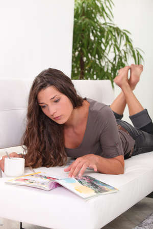 young woman relaxing on the sofa photo