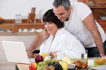 happy couple having breakfast photo