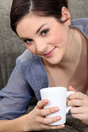 Young woman with a mug of tea Stock Photo - 11775182