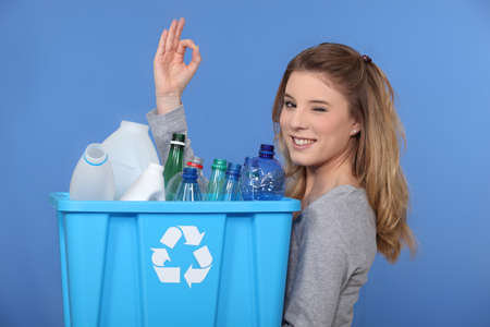 non verbal: Young woman taking out the recycling