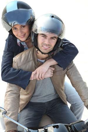 Couple on motorcycle helmet photo