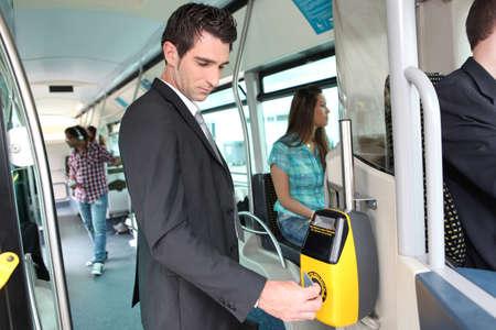 Businessman validating travel card photo