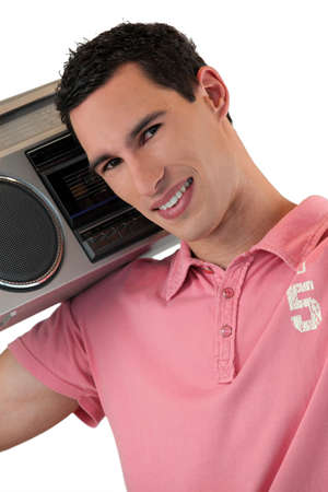high powered: Man listening to a boombox Stock Photo