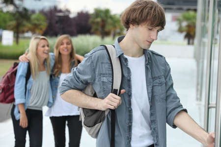 late teens: Three teenagers arriving at college