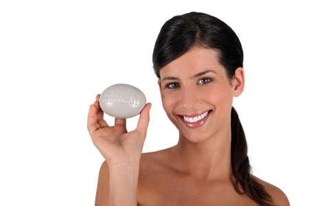 all smiles: Brunette all smiles holding soap