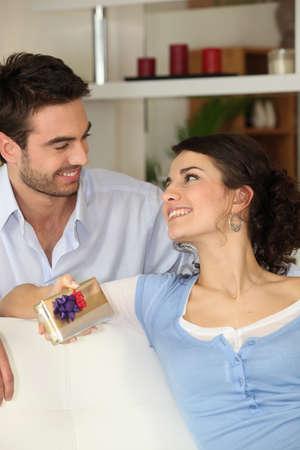 joy of giving: Man giving his girlfriend present