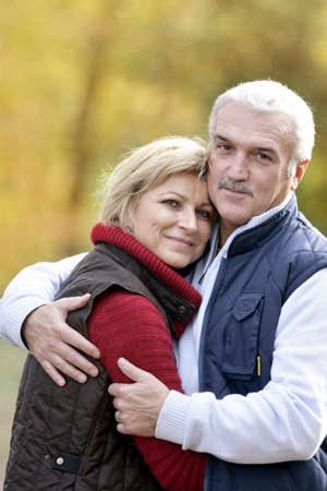 55 60 years: Portrait of a couple hugging