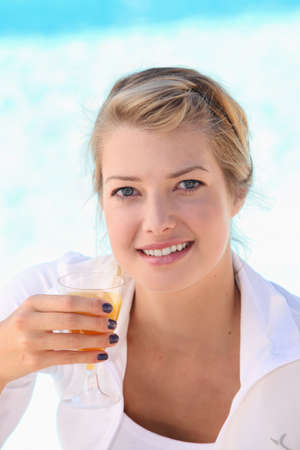 woman drinking orange juice Stock Photo - 11775184