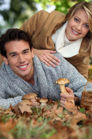Couple picking wild mushrooms photo