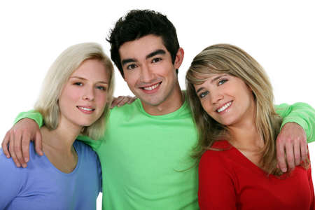 accomplices: Portrait of two young women with a man Stock Photo