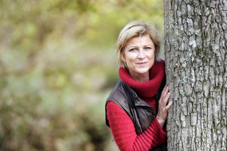 timid: Timid woman hiding behind a tree