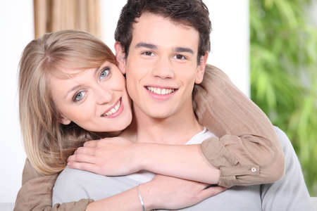 younger man: Woman embracing her boyfriend Stock Photo