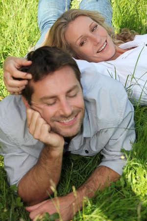 tickling: couple lazing  on grass