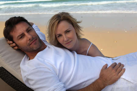 Couple relaxing on a deckchair photo